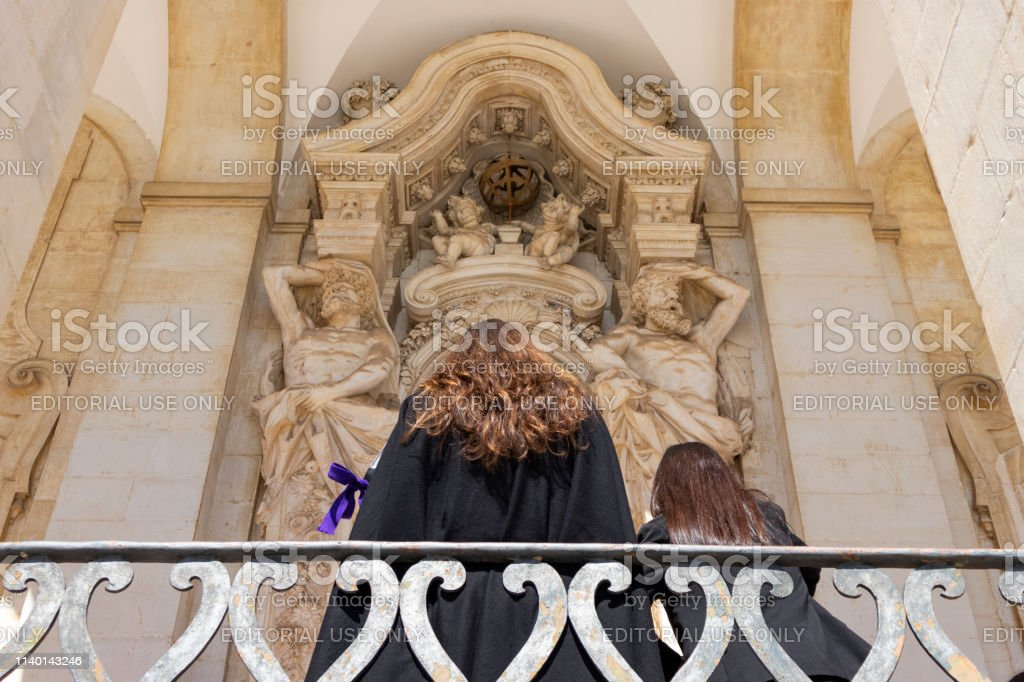 Girls waiting at the University of Coimbra, Portugal - stock photography - foto stock