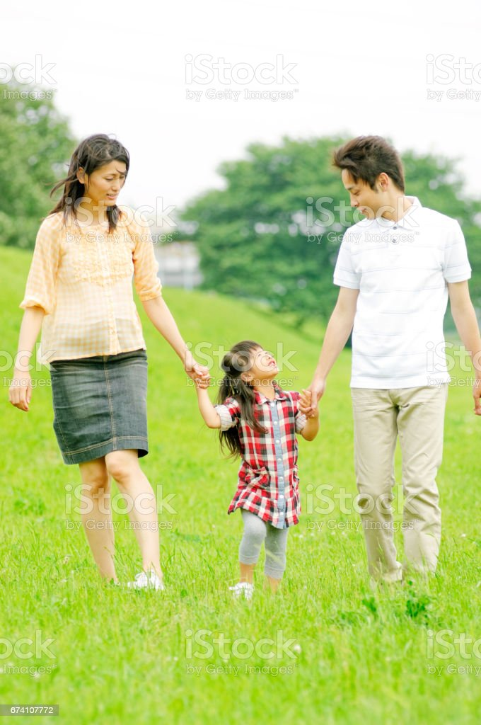 Girls walk hand in hand with parents royalty-free stock photo