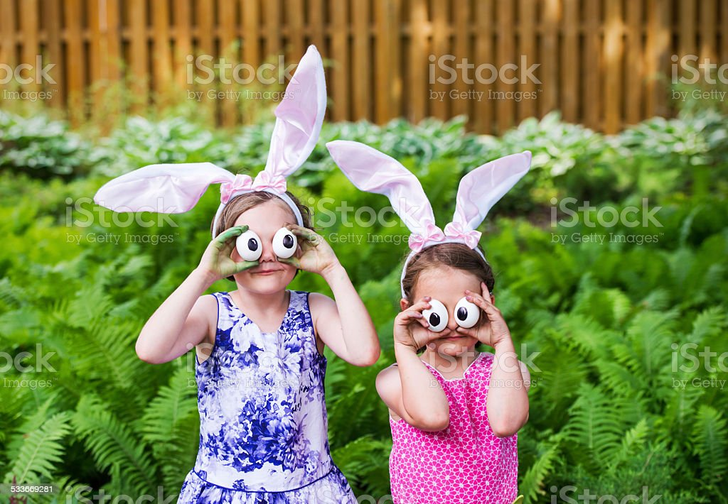 Girls Wearing Bunny Ears and Silly Eyes - Close Up stock photo