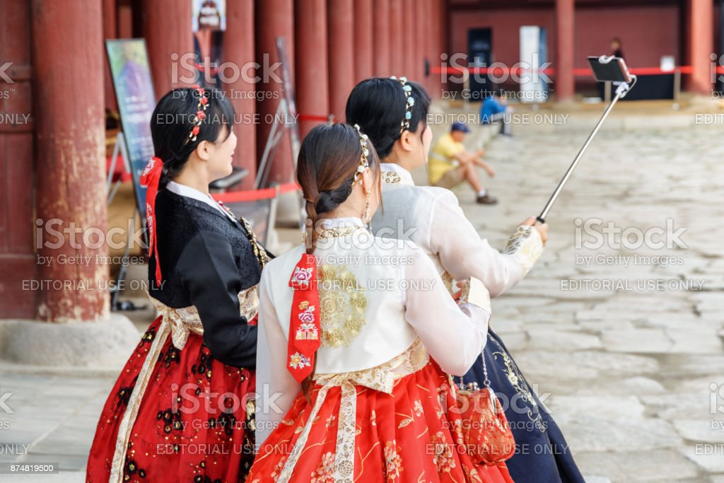 Girls wearing Korean traditional dress and taking pictures stock photo