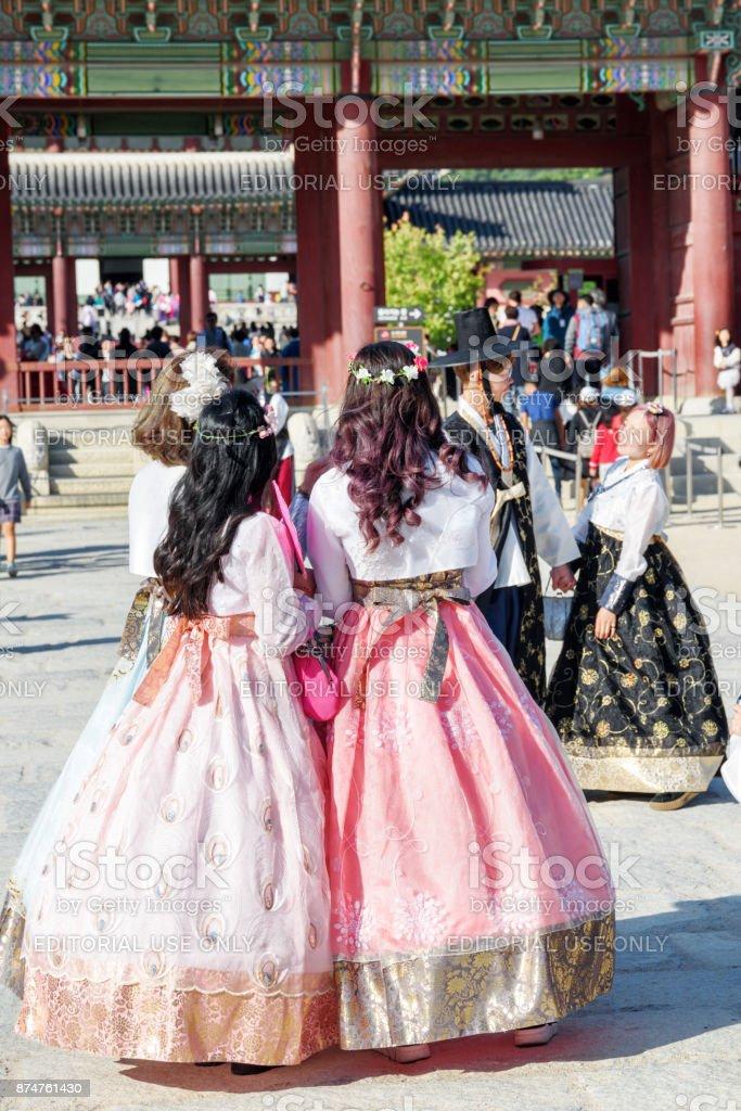 Girls wearing Korean traditional dress Hanbok, Gyeongbokgung stock photo