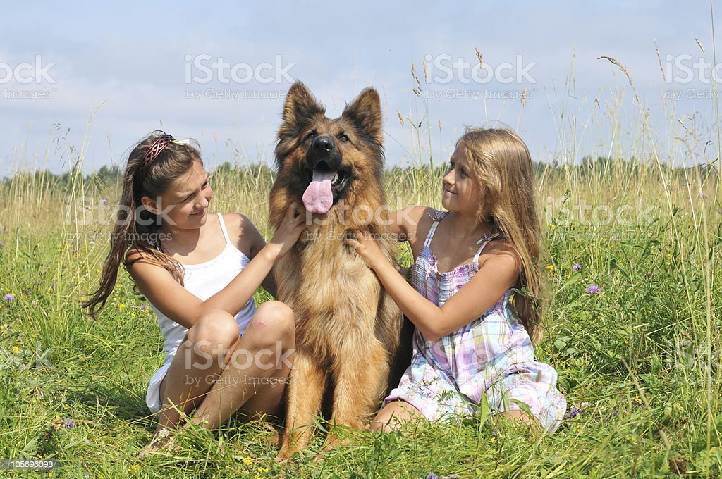 girls with a dog royalty-free stock photo