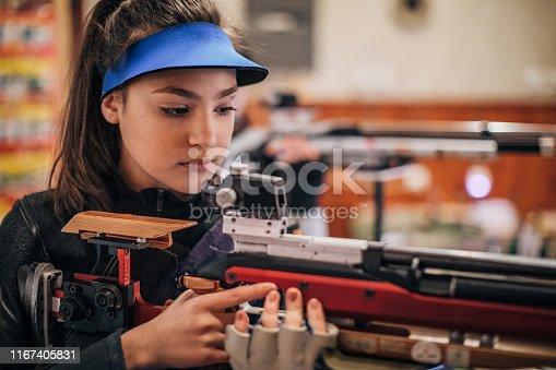 Girls with a machine gun practice target shooting