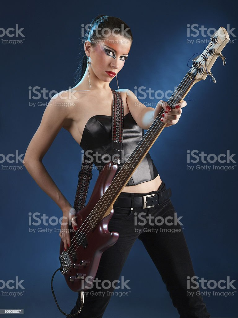 Girls with bass guitar royalty-free stock photo