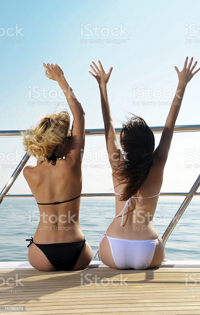 Girls with bikini on the yacht royalty-free stock photo