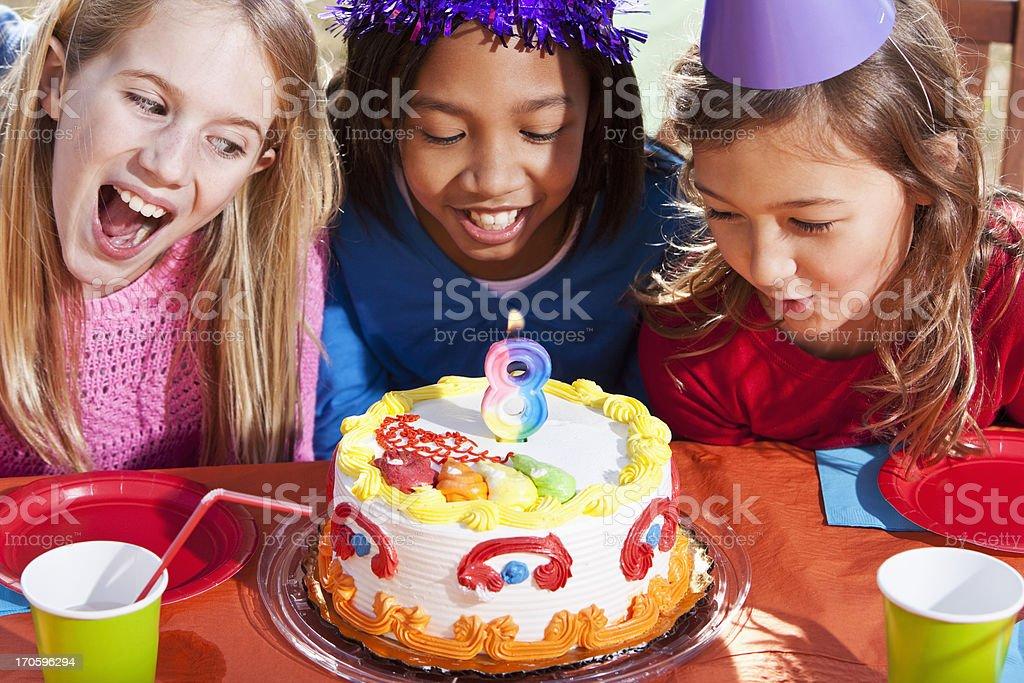 Girls with birthday cake royalty-free stock photo