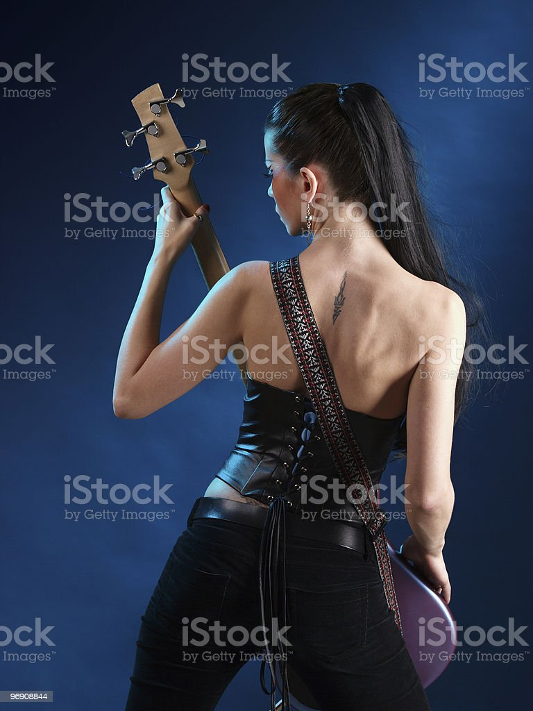 Girls with guitar from back royalty-free stock photo