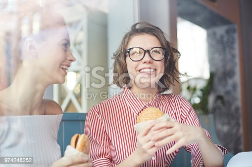 istock Girls with hamburgers 974248252