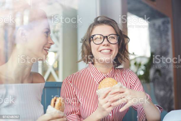 Girls with hamburgers picture id974248252?b=1&k=6&m=974248252&s=612x612&h=yaieafcd1zknmos2kcsubidjnkbvgsdght2azjj9d9o=