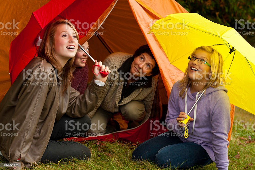 Girls With Moms at Tent Ready For the Rain royalty-free stock photo