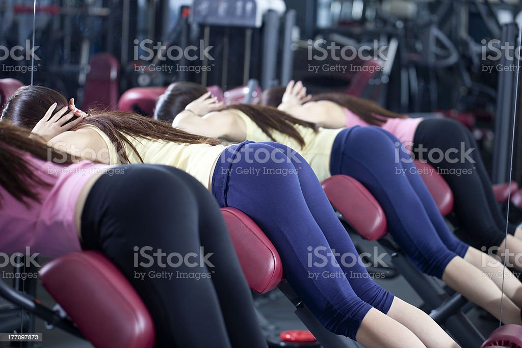 Girls With Perfect Buttocks In Gym - Abdominal Work Out stock photo