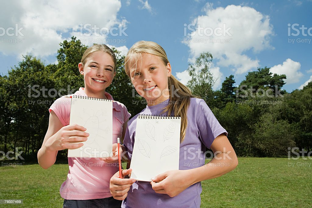Girls with  sketch pads 免版稅 stock photo