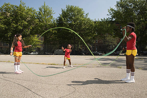Girls with skipping ropes stock photo