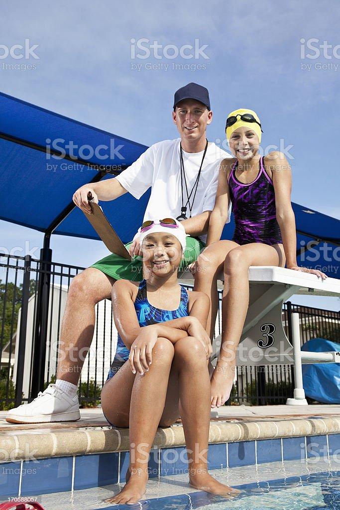 Girls with swim coach stock photo