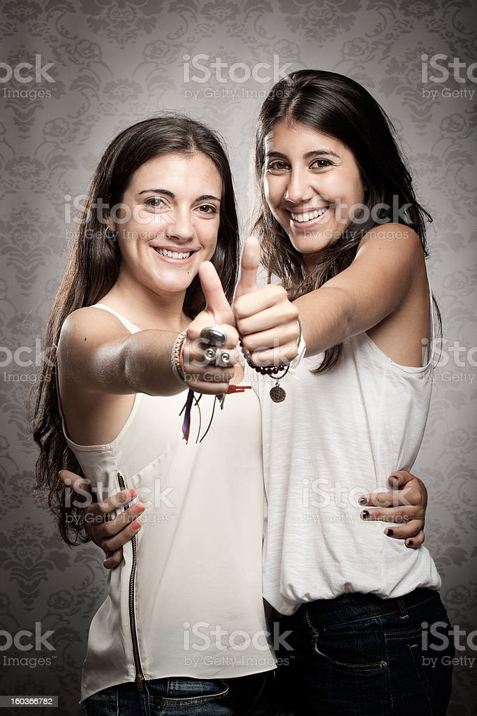 girls with thumbs up royalty-free stock photo