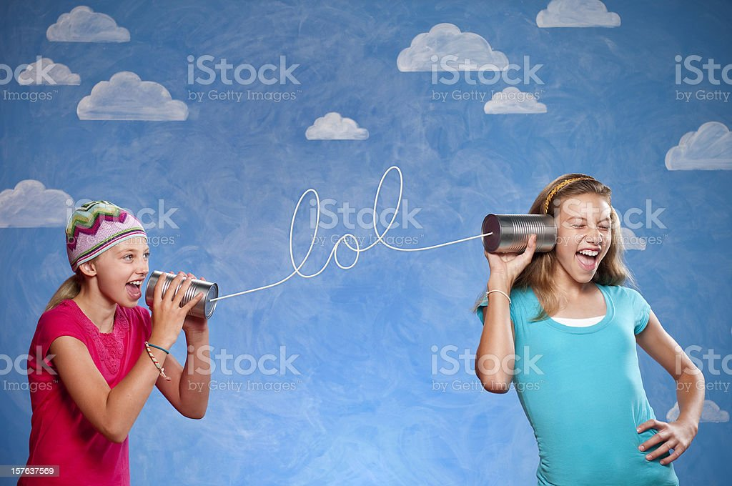Girls With Tin Can Telephones stock photo