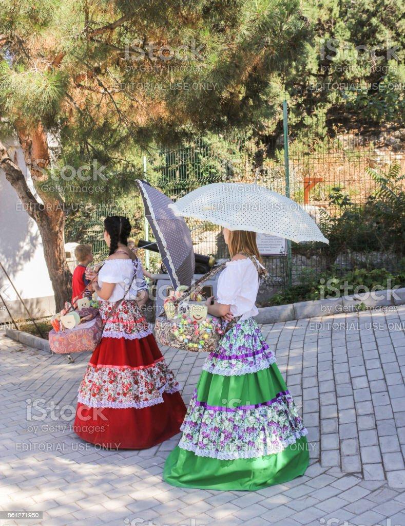 Girls with umbrellas. royalty-free stock photo