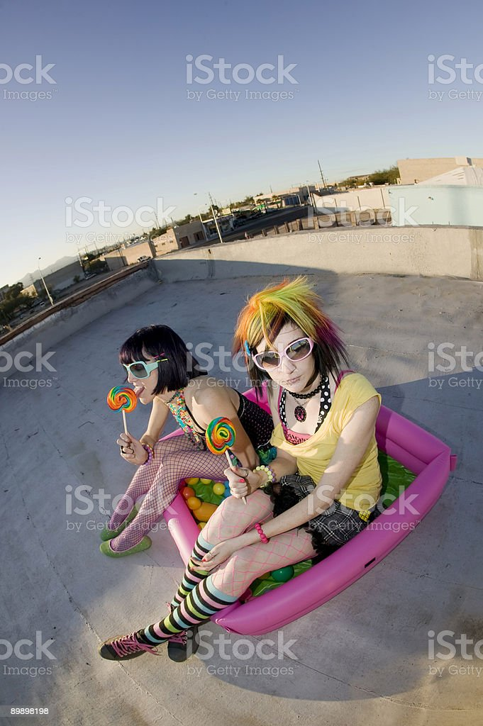 Girsl on a roof in plastic pool royalty-free stock photo