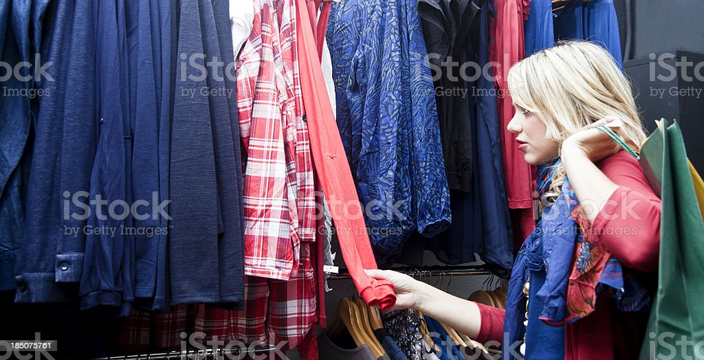 Giulr buying clothes royalty-free stock photo