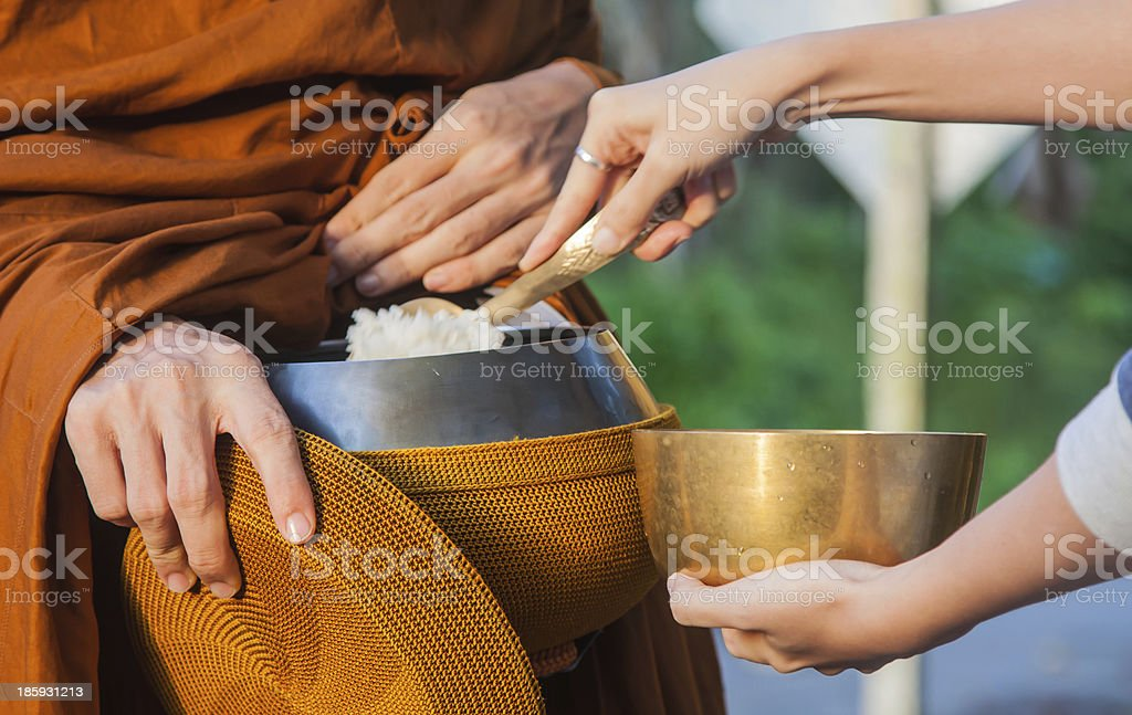 Give alms to a Buddhist monk stock photo