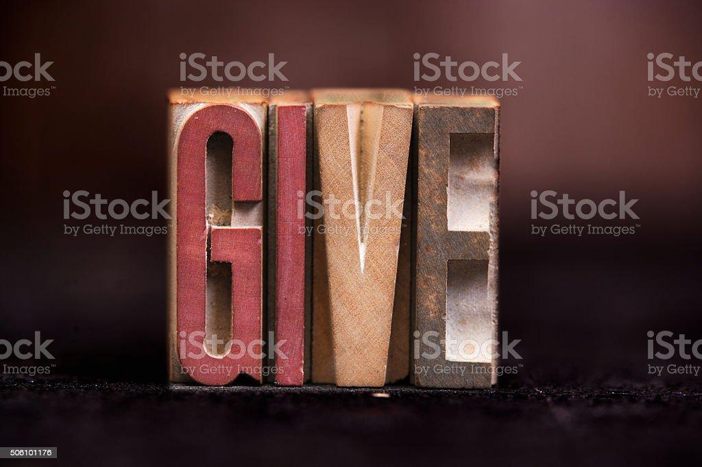 Give - Antique Letterpress Letters stock photo