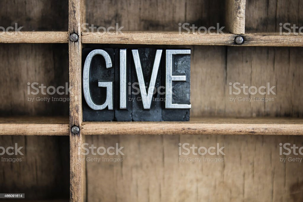 Give Concept Metal Letterpress Word in Drawer stock photo