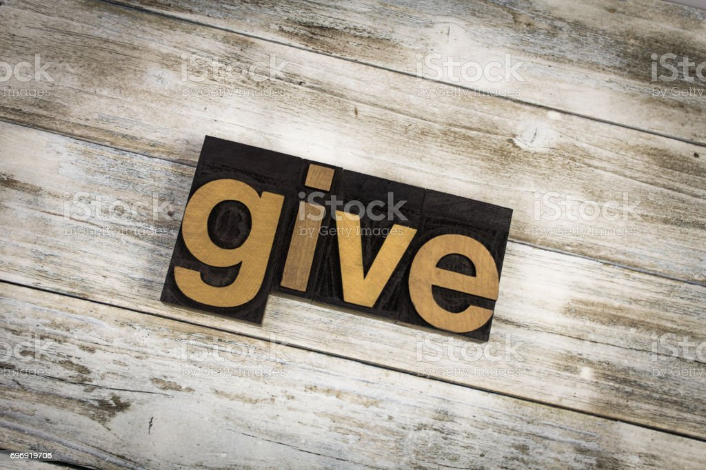 Give Letterpress Word on Wooden Background stock photo
