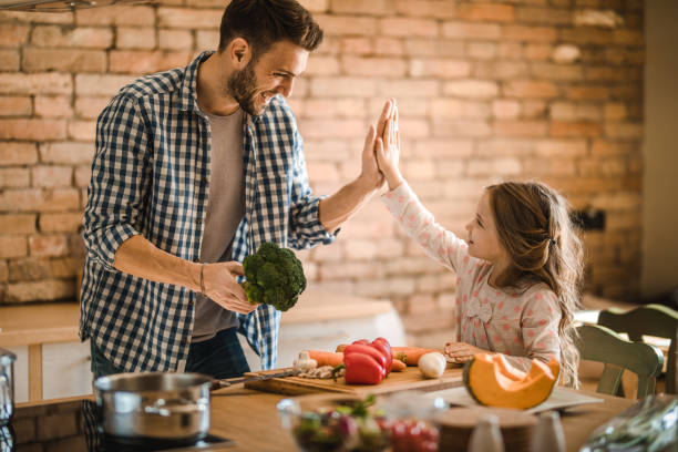Give me high-five! We will make a great lunch together! stock photo