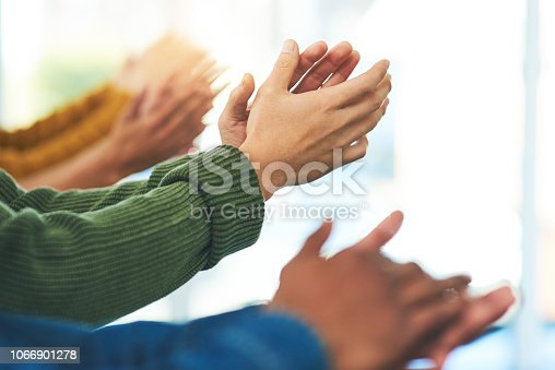 Closeup shot of a diverse group of people applauding together