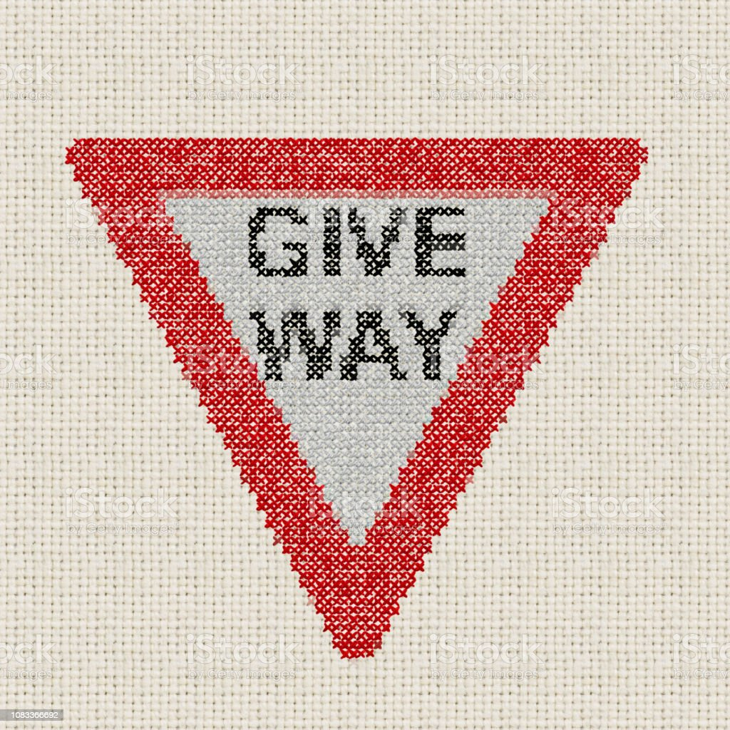 give way embroidered sign  Embroidery by contributor stock photo