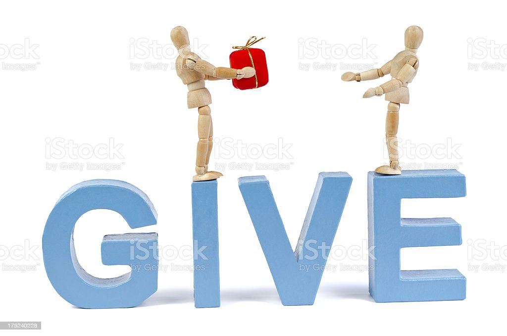 Give - Wooden Mannequin demonstrating this word royalty-free stock photo