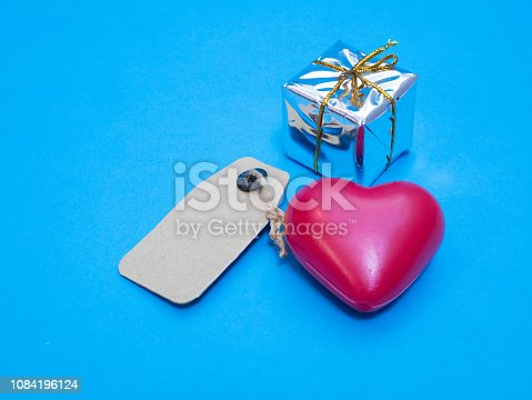 give you my heart as a gift. red heart with shiny small box and blank label for best wishes