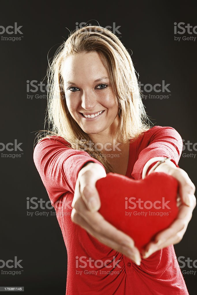 I give you my heart: pretty blonde offers valentine token stock photo
