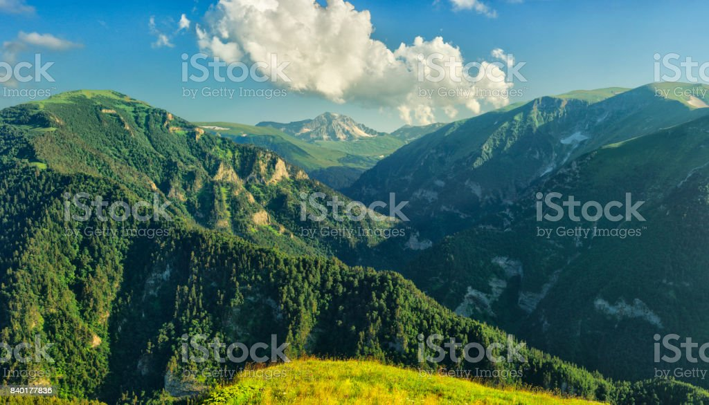 Given a wooded mountain in stormy weather stock photo