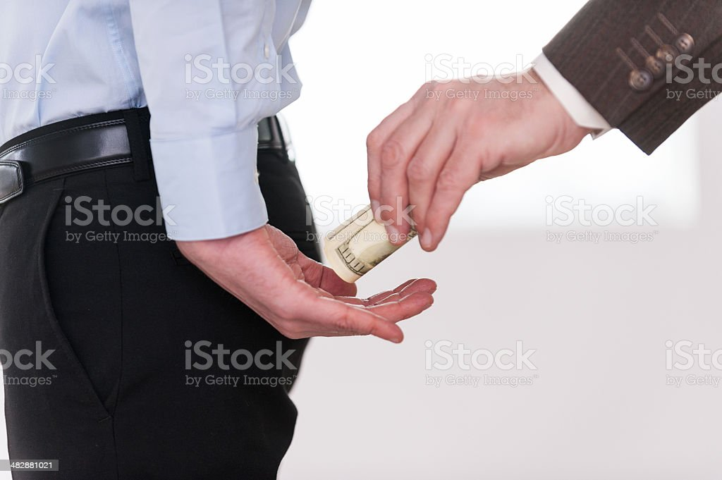 Giving a bribe. stock photo