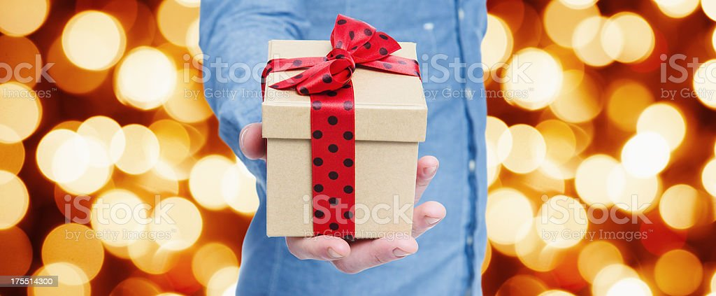 Giving a gift for Christmas royalty-free stock photo
