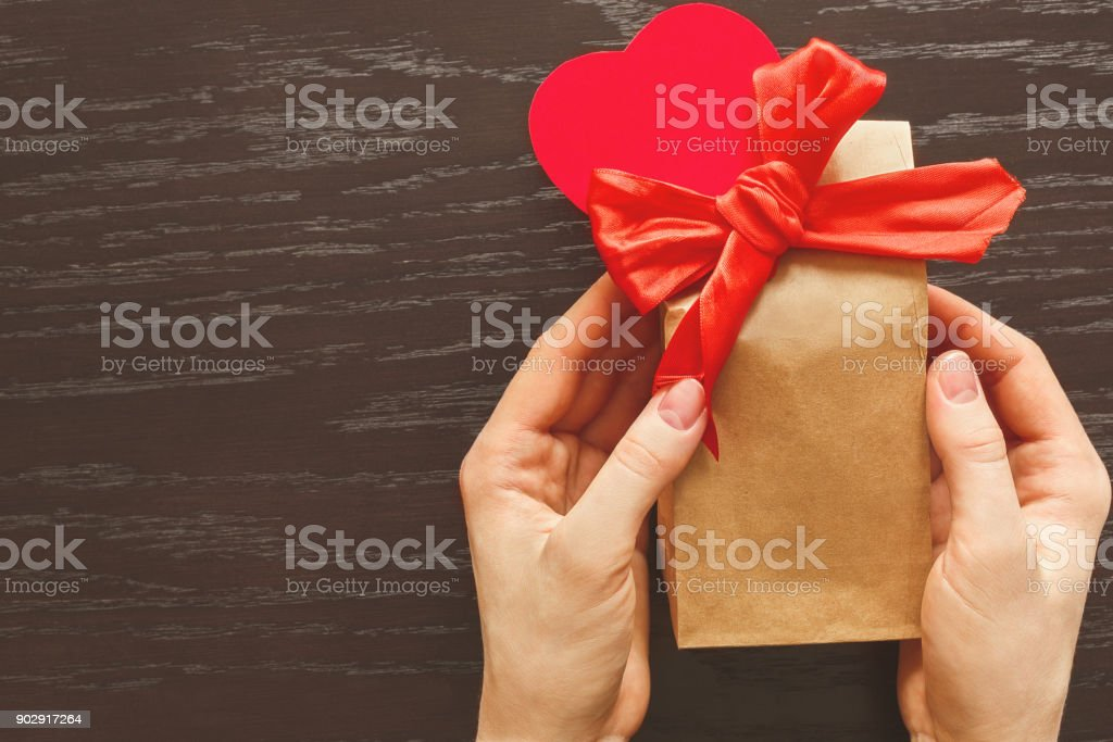 Giving a gift in celebration of Valentine's day stock photo