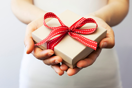 Giving A Gift Stock Photo - Download Image Now