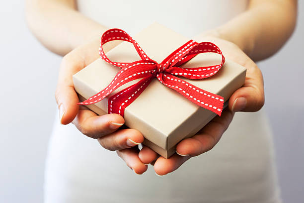 Giving a gift stock photo