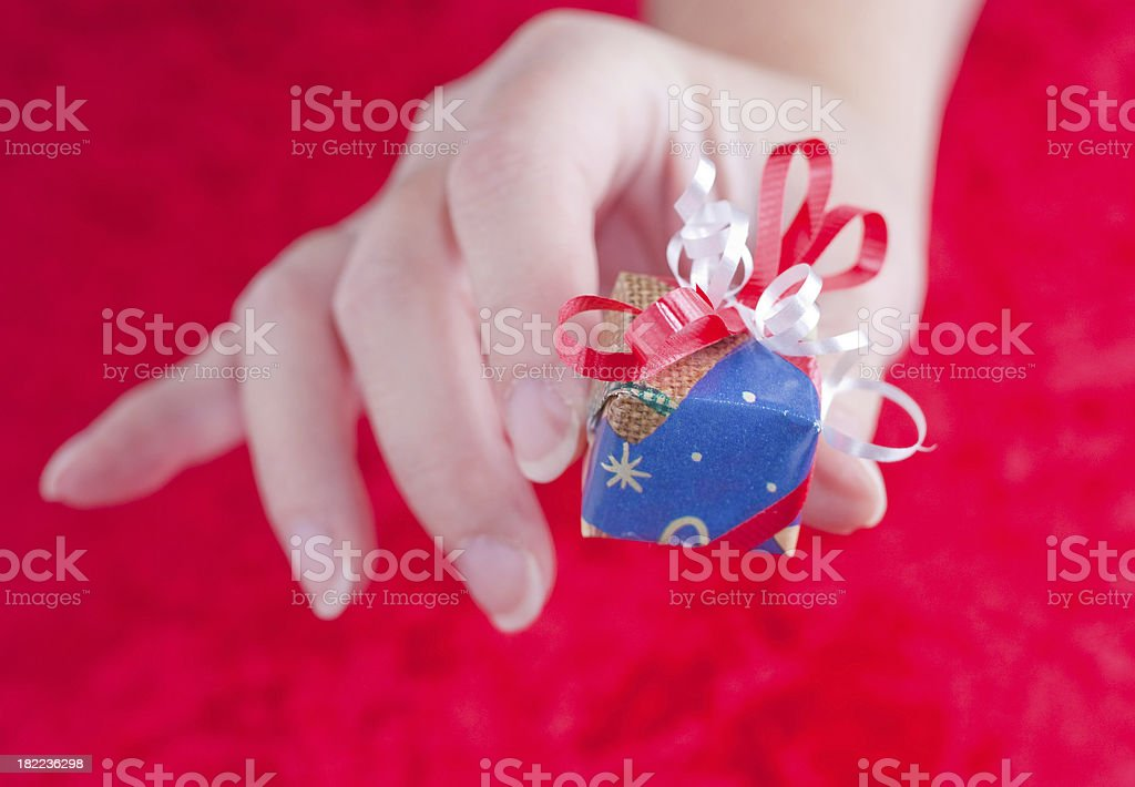 Giving a Little Gift royalty-free stock photo