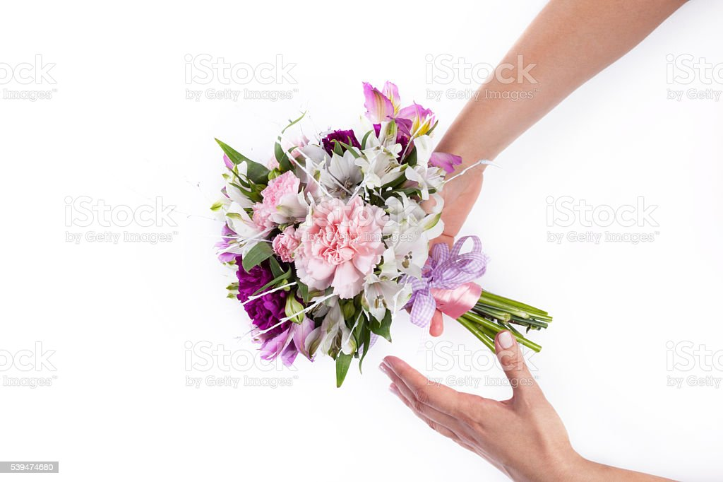 Giving a pink bouquet from gillyflowers and alstroemeria on whit stock photo