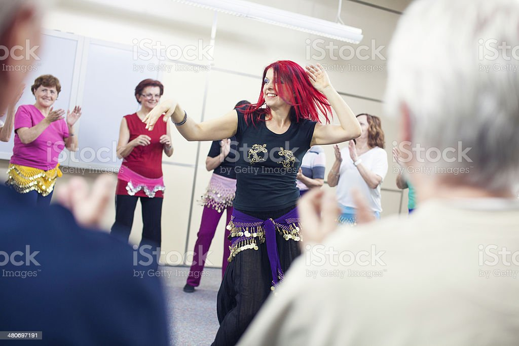 Giving Accompaniment To Professional Belly Dancer stock photo