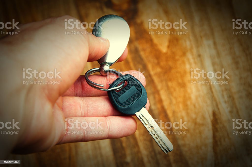 Giving and taking metal key. Video illustrates idea of renting stock photo