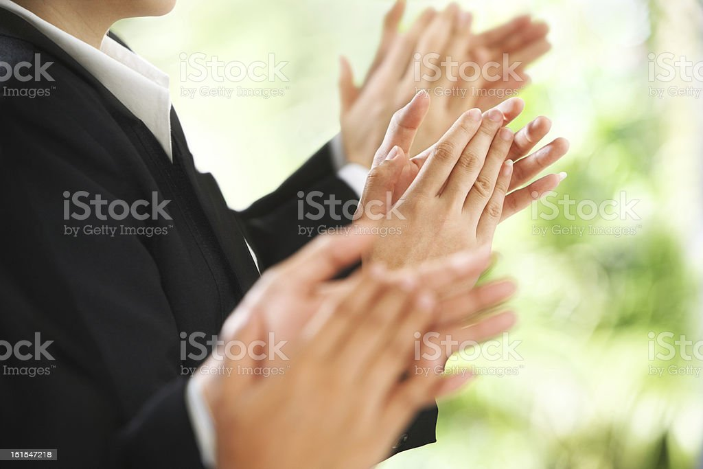Giving applause over green background royalty-free stock photo