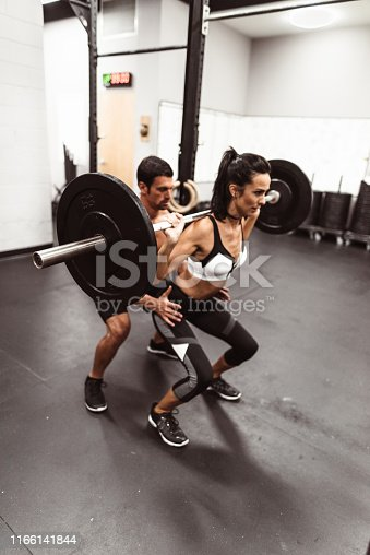 610237160 istock photo giving assistance to the squat woman 1166141844