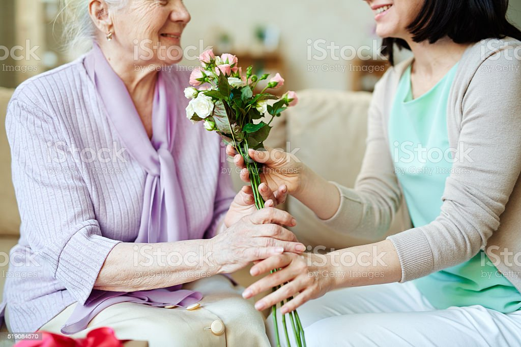 Giving bunch of fresh roses stock photo