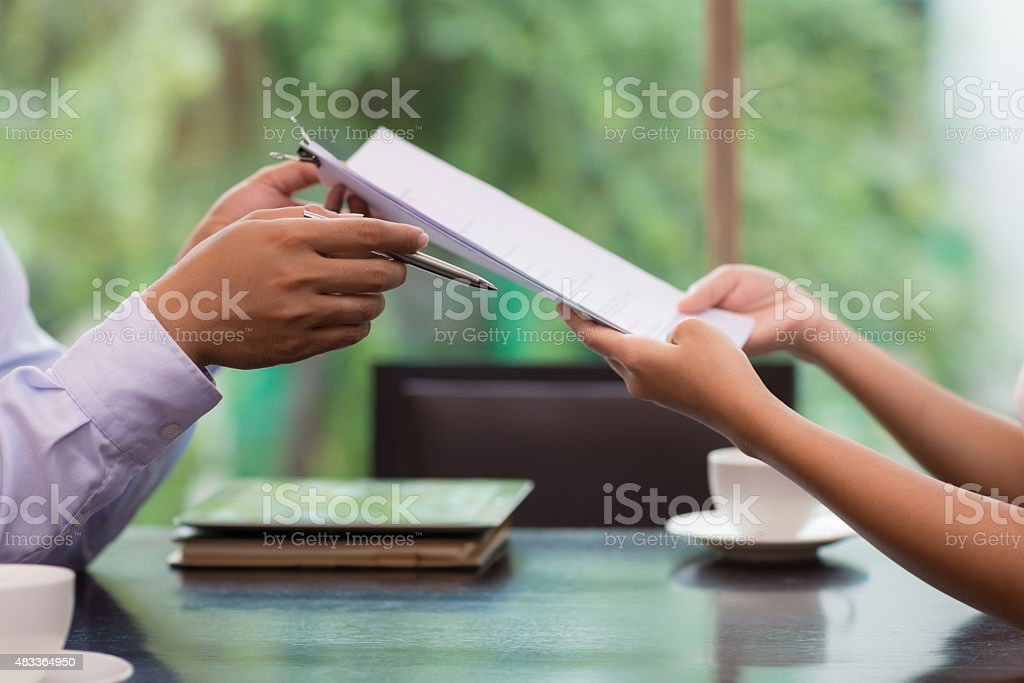 Giving business documents stock photo