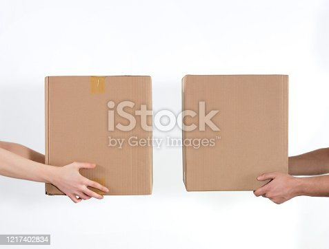 Couple giving cardboard boxes to each other