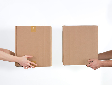 istock Giving carboard boxes 1217402834