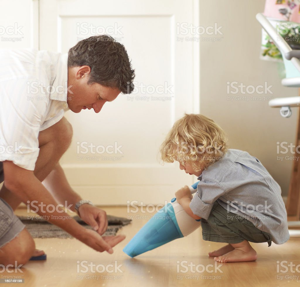 Giving dad a helping hand stock photo